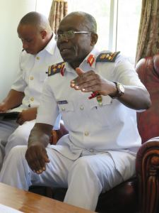 Commander of the Tanzania Navy, Brigadier General Rogastian Laswai discusses maritime security matters with Commander Combined Task Force 150, Commodore Daryl Bates, Royal Australian Navy (not pictured) in Dar es Salaam.