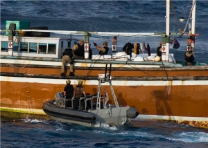 A Naval Boarding Team from HMCS Toronto boards a suspect vessel in January 2014 off the coast of Tanzania. A subsequent search of this vessel revealed 281 kilograms of heroin hidden onboard.