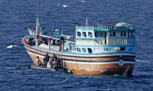 A boarding party from HMAS Melbourne intercept a dhow suspected of being used for illegal puposes in the Middle East Area of Operations.