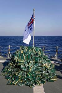 Nearly two tonnes of hashish lays piled on HMAS Melbourne's flight deck in the Middle East Area of Operations following a successful narcotics inderdiction operation.