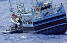 The boarding team from HMAS Melbourne boards the suspect vessel off the Tanzanian coast.