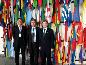 Commodore Daryl Bates (right) and Commander Douglas Ward (left) with Mr Hakan Demirbuken, Programme Management Officer for the UNODC Afghan Opiate Trade Project, at the entrance to the Commission in Vienna, Austria