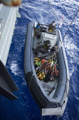 One of HMAS Darwin's ridged hull inflatable boat transports seized heroin from the boarded vessel, back to the ship for processing and destruction.