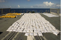 HMAS Darwin's boarding party members seized over one tonne of heroin from a boarding conducted on a suspicious vessel.