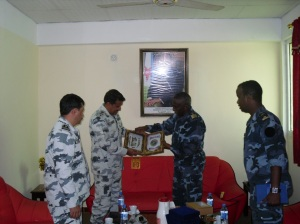 Commodore Ali Abbas (centre left) exchanges gifts with Colonel Abdourahman Aden Cher, Djibouti Chief of Navy (centre right).