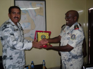 Commodore Ali Abbas (l) exchanges gifts with Lt Mohamed Adawa Mohamed, Second in Command Djibouti Coast Guard (r).