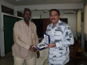 Commodore Ali Abbas (r) exchanges gifts with Mr Hassan Said Khaireh, Director Djibouti National Security Council (l).
