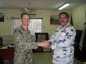 Commodore Ali Abbas (r) presents crest to Captain Shawn Duane (USN), CJTF-HOA Chief of Staff (l).