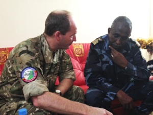 Commodore Blunden explains CTF-150 operations to Col Cher, the Commander of the Djibouti Navy.