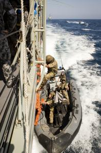 HMS Somerset sails astern of HMAS Darwin during maritime security operations in the Arabian Sea.