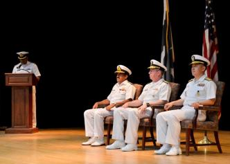 Vice Adm. John W. Miller, centre, Commander Combined Maritime Forces, along with Commodore Ali Abbas, left, of the Pakistan Navy, former commander of Combined Task Force (CTF) 151, and Rear Adm. Cho Young-joo, Republic of Korea Navy, sit during the conclusion of the CTF-151 change of command ceremony.