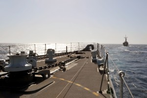HMS Somerset's bow with HMAS Darwin in the distance.