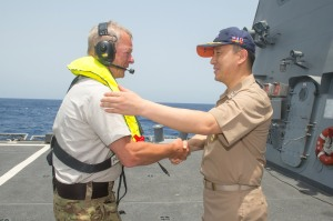 Rear Admiral Cho Young Joo welcomes Commodore Aage Jensen aboard ROKS Munmu the Great.