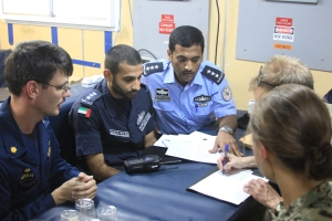 The Commanding Officers of USCGC Adak, USS Sirocco and UAE Coast Guard vessel Al-Sadeeq discuss the exercise.