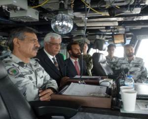 Commodore Mahmood and HE Ambassador Khan receive a briefing on aircraft carrier operations