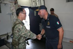 Rear Admiral Guido Rando bids Captain Kim Jeong-Hyun farewell