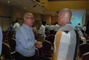 Mr John Steed MBE from Oceans Beyond Piracy in discussion with Captain William Naught US Navy from the Combined Maritime Forces