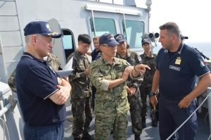 Rear Admiral Guido Rando in discussion with Captain Kim Jeong-Hyun