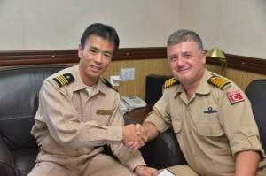 Captain Okawa and Commander Tigli meeting onboard TCG Gemlick
