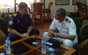 Cdre Tony Millar, MNZM, RNZN discussing counter piracy operations with Cdr Anand Kulkarni, CO of INS Sumedh
