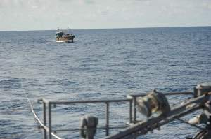 Dhow being towed by JS Takanami