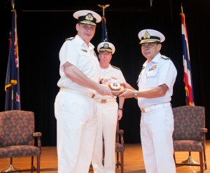 Commodore Tony Millar from the Royal New Zealand Navy hands over command of CTF-151 to Rear Admiral Pakorn Wanich from the Royal Thai Navy as Vice Admiral John W Miller, the US Navy's Fifth Fleet Commander and Commander of the Combined Maritime Forces, looks on
