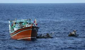 HMAS Toowoomba's ships boat close in on the suspicious dhow