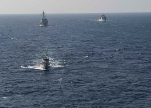 USS Dewey, HMS Yanbu and YCG Sana'a conducting manoeuvers during Focused Operation Taawun al Behr.