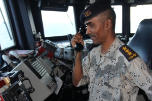 Yemeni Coast Guard Sea Rider carrying out query procedures on the bridge of USS Dewey during Focused Operation Taawun al Behr.