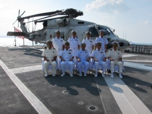 Rear Admiral Pakorn Wanich with Japanese officers onboard JS Takanami in Djibouti on 9th December 2014