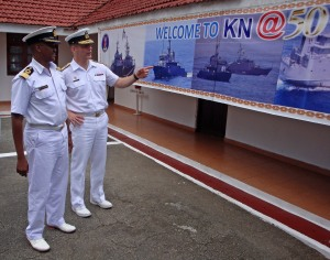 Commander Combined Task Force (CTF) 150, Commodore Brian Santarpia, and Deputy Commander Kenyan Navy (KN), Brigadier General CM Kahariri, discuss the KN's recent 50th anniversary.