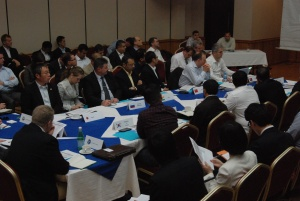 Delegates listen to a briefing at the 34th SHADE meeting in Bahrain