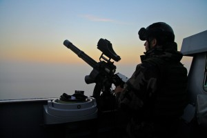 A sailor from FS Guepratte stands sentry while the frigate transited south through the Suez Canal last week