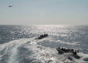 Crew members of USS Dewey ride rigid-hull inflatable boats during a recent boarding training exercise