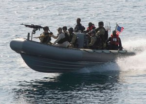 Members of the Arleigh Burke-class guided-missile destroyer USS Dewey boarding team operate in a rigid-hull inflatable boat during a recent training exercise