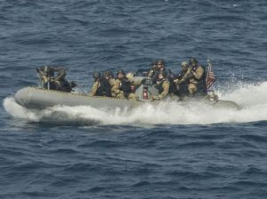 The boarding team from USS Dewey prepares to search a dhow