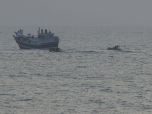 The boarding team approaches a dhow