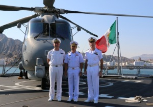 Rear Admiral Guido Rando from the Italian Navy and Commander of CTF-465, Rear Admiral Pakorn Wanich from the Royal Thai Navy and Commander CTF 151, and Captain Virdis, Commanding Officer of the ITS Andrea Doria, on the ship's flight deck