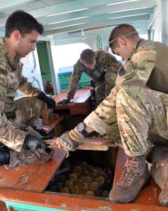 Royal Marines conduct a thorough search of the vessel