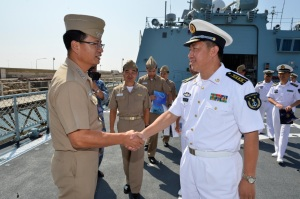 Captain Hwang Sun-Woo (left) was welcomed onboard the Chinese frigate Lin Yi by Senior Captain Wang Peiji (right)