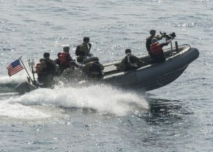 USS Dewey's boarding team approaches a dhow during maritime security operations