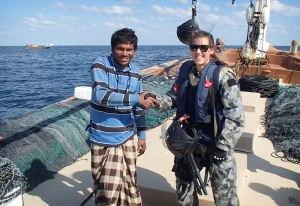 A Boarding Team member from HMAS Success meets a local mariner on a fishing dhow on one of six boarding operations conducted successfully in the Gulf of Oman. Positive maritime engagements continue to develop Combined Maritime Forces' relationship with mariners in the region.