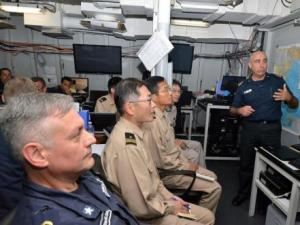The EU Naval Force staff brief the crew from JS Harusame