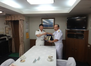 Commander Kunio Aoki, Commanding Officer of JS Harusame, with Rear Admiral Pakorn Wanich from the Royal Thai Navy and Commander CTF-151