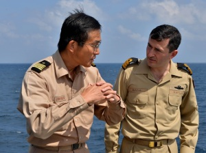 Captain Masatoshi Kashihara from the JS Harusame in discussions with Lieutenant Commander Ali Tuna Baysal, Commanding Officer of the TCG Buyukada