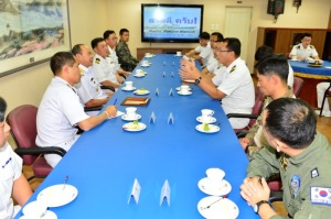 Rear Admiral Pakorn Wanich from the Royal Thai Navy and Commander CTF-151 was briefed by the ship's Operations Officer during the meeting with Captain Sun-Woo Hwang, Commanding Officer of ROKS Dae Jo Yeong