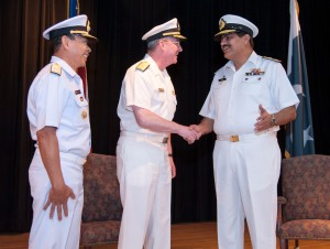 Vice Admiral John W Miller congratulates Commodore Asif Hameed Siddiqui SI(M) on his acceptance of the command of CTF-151