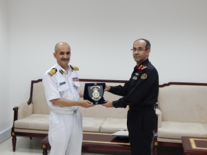 Captain Shames Al Husby Royal Navy of Oman and Captain Suliman Al-Enazi Royal Saudi Naval Forces exchange a gift as a sign of the friendship between CMF and Oman