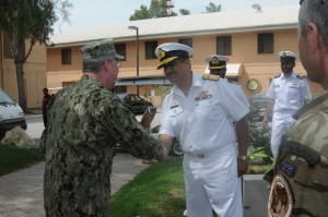 Commodore Asif Hameed welcomes Vice Admiral John Miller to the 76th Pakistan Day
