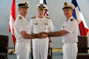 Vice Admiral John Miller Commander Maritime Forces looks on as Commodore Brian Santarpia Royal Canadian Navy hands over command to René-Jean Crignola